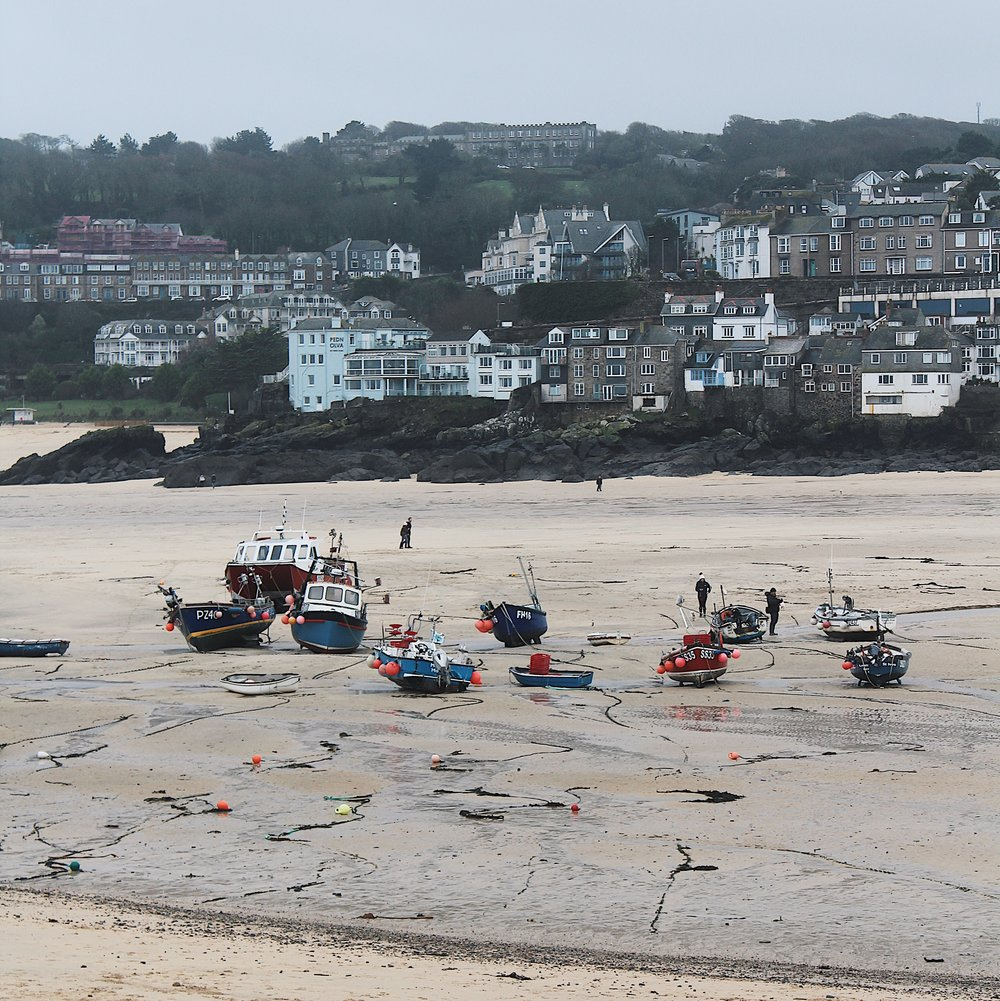The harbour of St Ives.  I love the way the small fishing boats are left stranded on the sand.