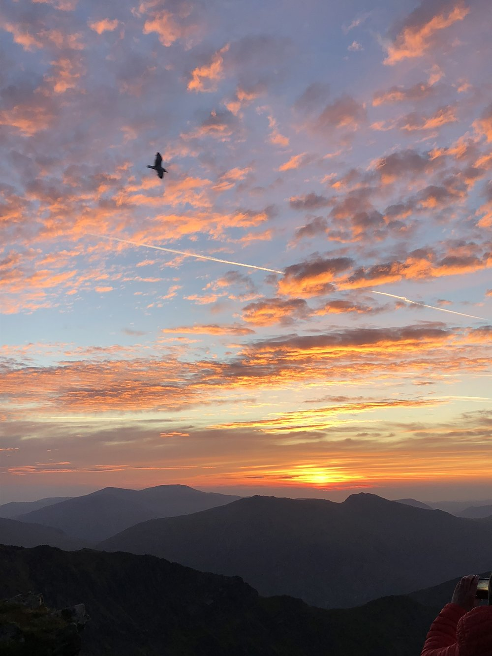 The sun rising from Snowdon's summit. This photo does not even do the view justice. The sky looked like it was on fire. Seeing this view touched me so much, it was awesome.