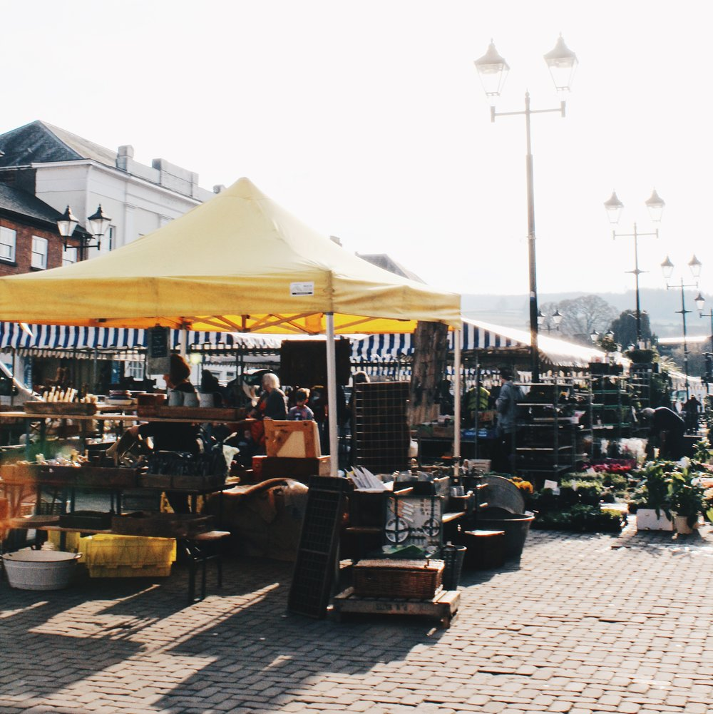 The market that is in the square in front of the castle. There are a variety of stalls including vintage, plants, vegetables, food and textiles.