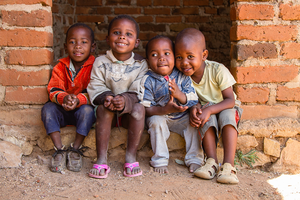 Children Waiting Outside A Loan Meeting