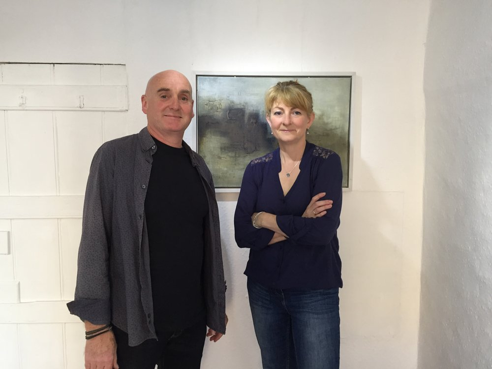 Janet and Donagh at the opening of their joint show, beside Donagh's painting One Hundred Paces from his Three Towers series, based on the historic Three Castles Head on the Mizen peninsula.