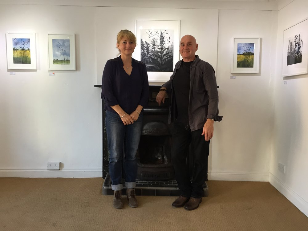 Before the guests arrive for the official exhibition opening, Donagh Carey with Janet Murran and her Garden of Eden painting series