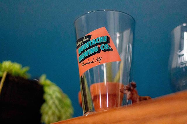 We love this retro postcard-style pint glass. Come check out our collection of merch in the brand-spankin-new tasting room! #moustachebrewing