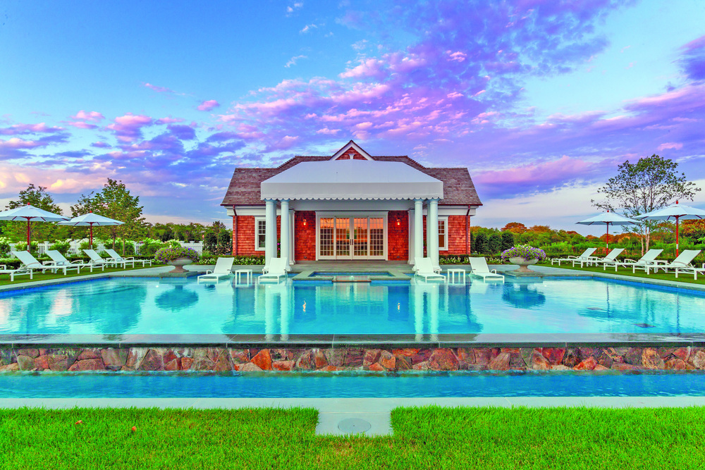 The pool house complements the home and surroundings but stands out as a work of art with vanishing edge 60' x 34' gunite pool