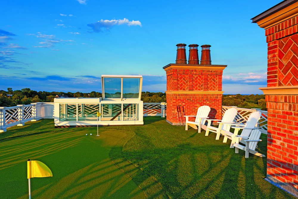 Enjoy putting practice or a friendly competition on the roof with views for miles