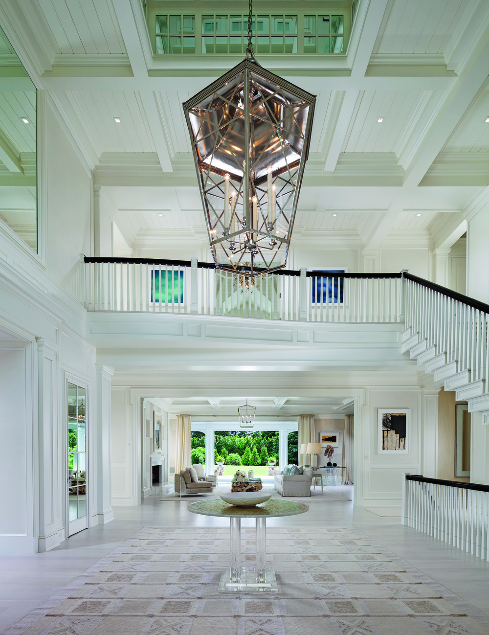 The grand entry foyer is an elegant statement of reflection and light