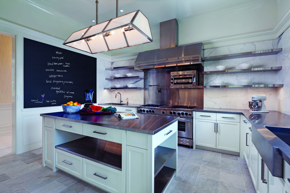 Above: An ancillary professional chef's kitchenallows caterers to work out of sight and the family kitchen (below) - a place to gather and entertain