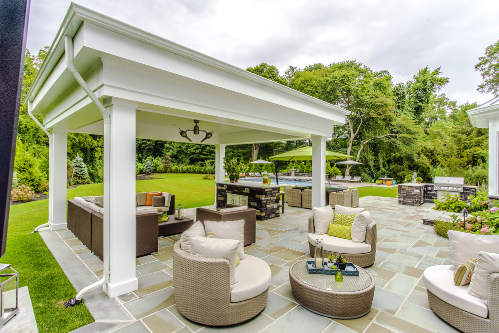 Splashes of color abound in this outdoor living space. Accommodations were made for ample lounging around the pool.