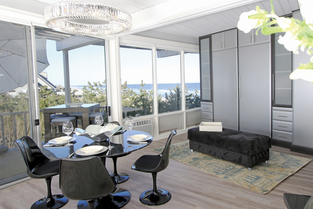 When dining with an ocean view, one would never suspect that a Murphy closet bed system is hiding in the adjacent wall.