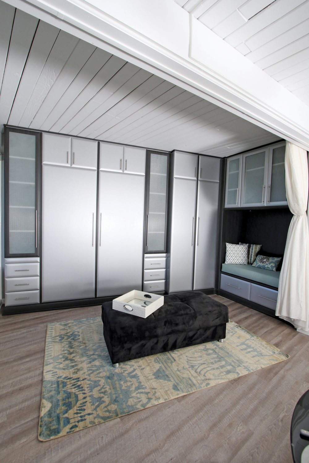 Every inch in this less than 600 square feet is maximized for storage. Closets, bed, drawers and TV where there is even a niche for reading and relaxing.