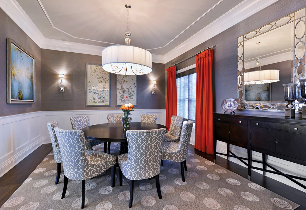 Inspiration for this room was the client's existing artwork. Pairing Kravet's grasscloth wall covering with a custom mirror and bold linen panels creates a warm dining experience.
