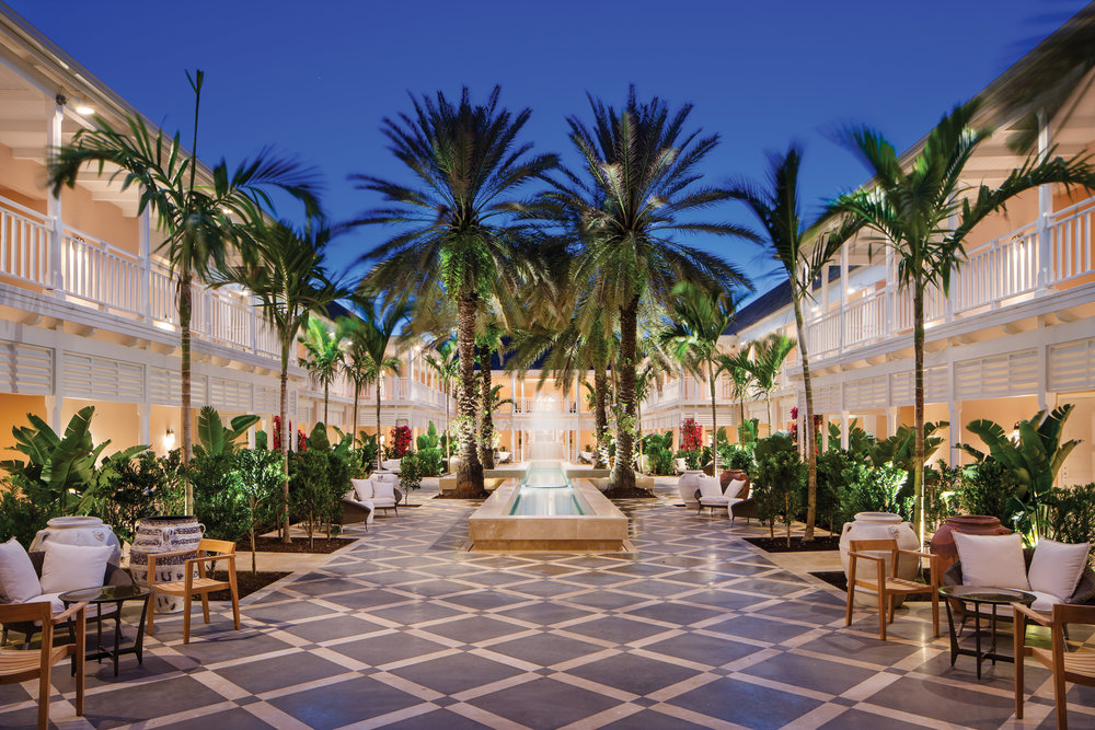 The accommodations are all arranged around a burgeoning, lush and  colorful courtyard with cross-shaped fountain.