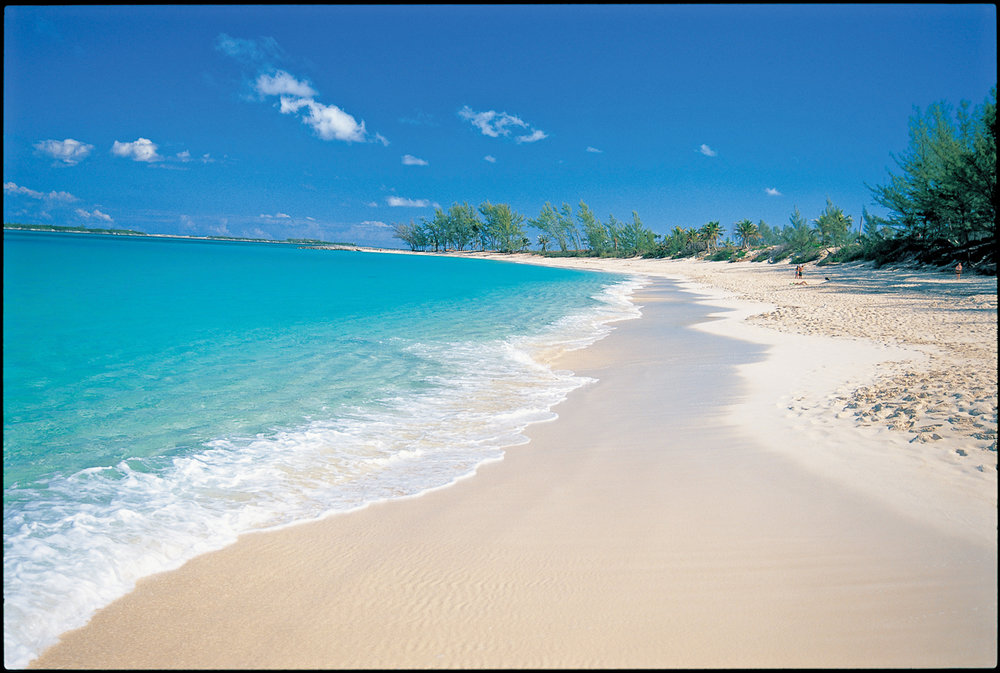 The pristine white sand beach against turquoise waters entices you to walk as far as your legs are willing to take you.