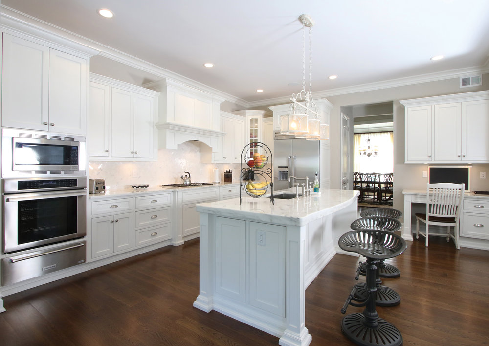 "The clean, crisp ""white on white"" kitchen is perfect for this young family as well as for entertaining."