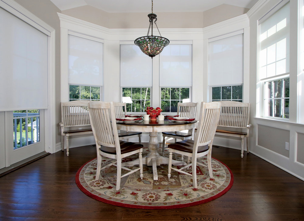When gathering in the breakfast room, the family enjoys a panoramic view of their back yard.