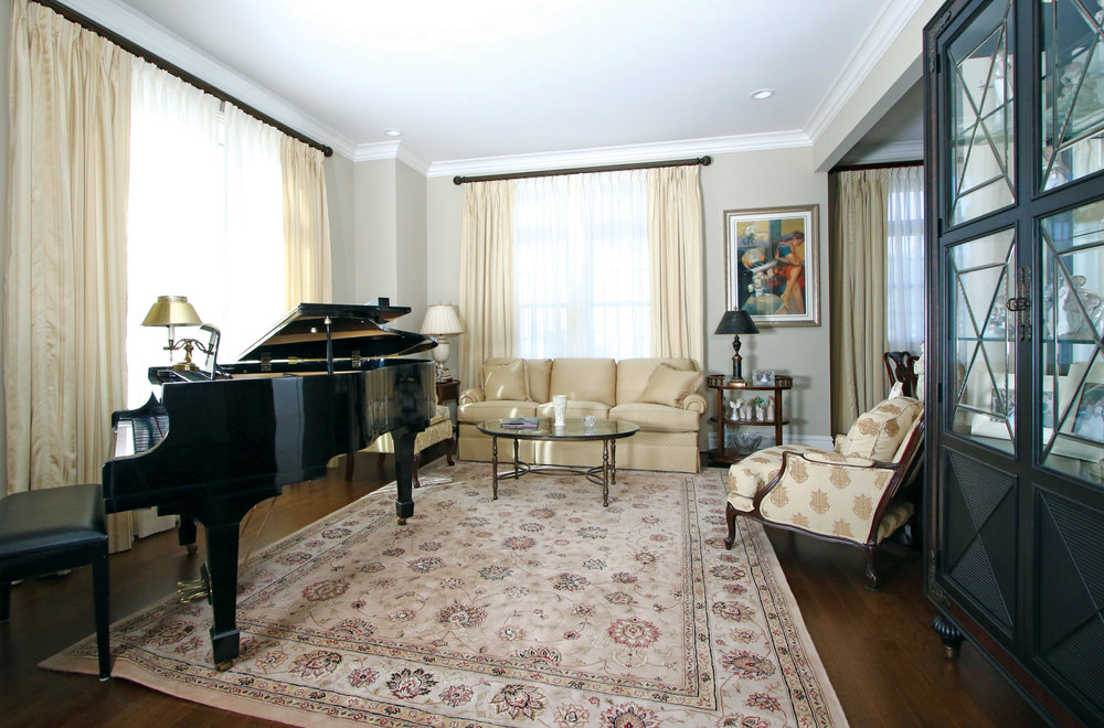 This living room/music room houses family collectibles and a player piano which is also played by the children.