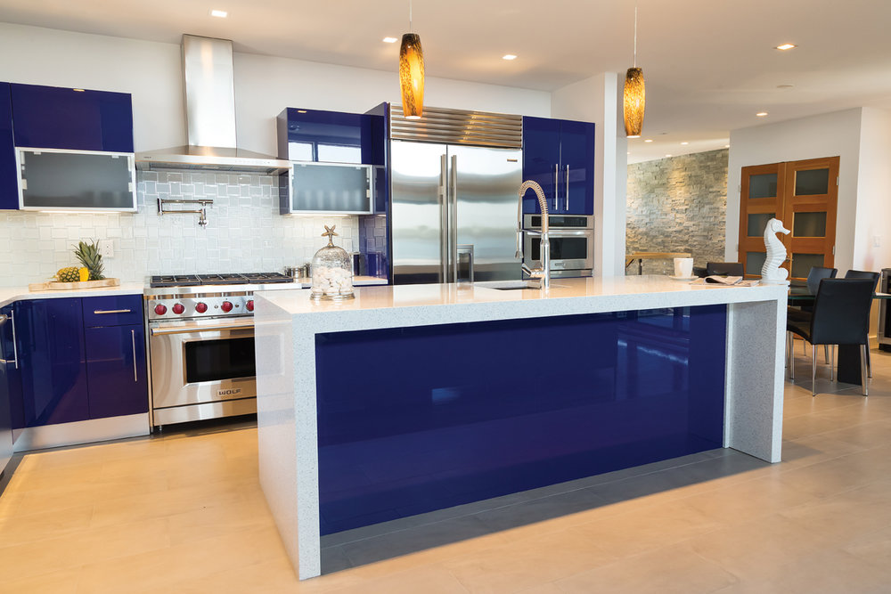 Michael Rosenberg, Showcase Kitchen, provided an eye-catching look for every element of this kitchen including stainless steel toe kicks and 3-inch thick mitered waterfall Quartz countertop on the center island.
