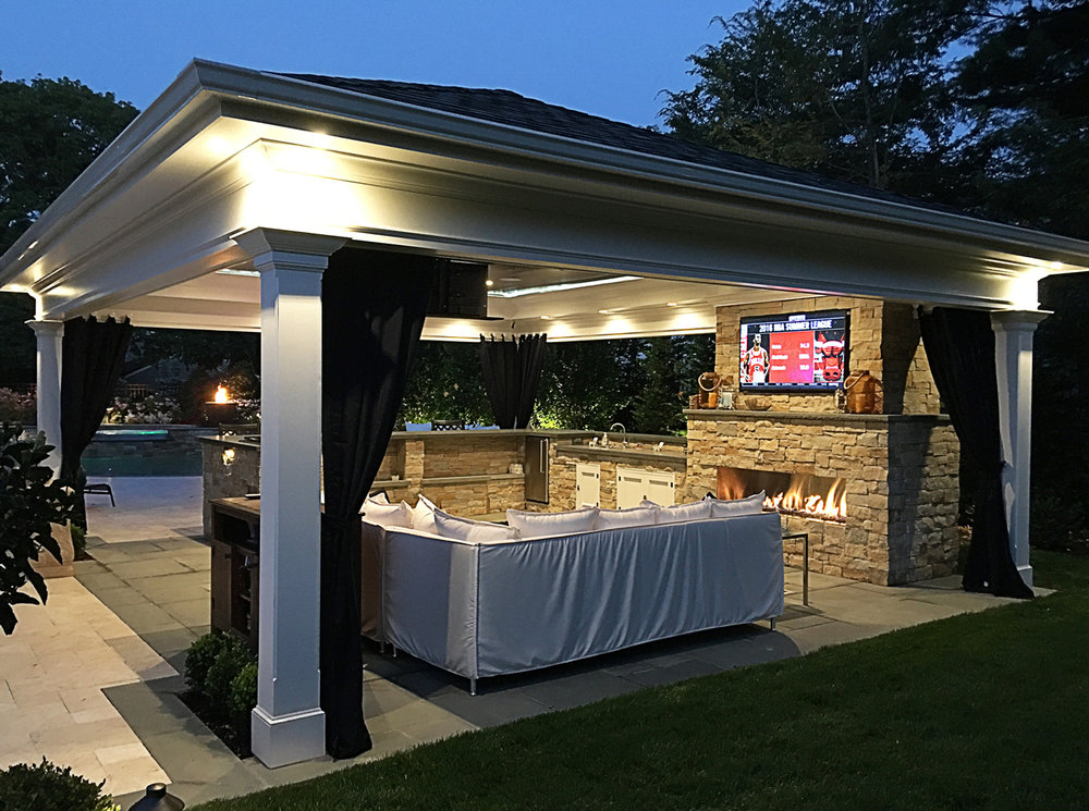 Underneath the cabana, Pennsylvania thermal Bluestone is used to break up the marble on the pool and dining terraces. Architectural detail is highlighted with crown moldings, columns and a stained bead board for the ceiling.