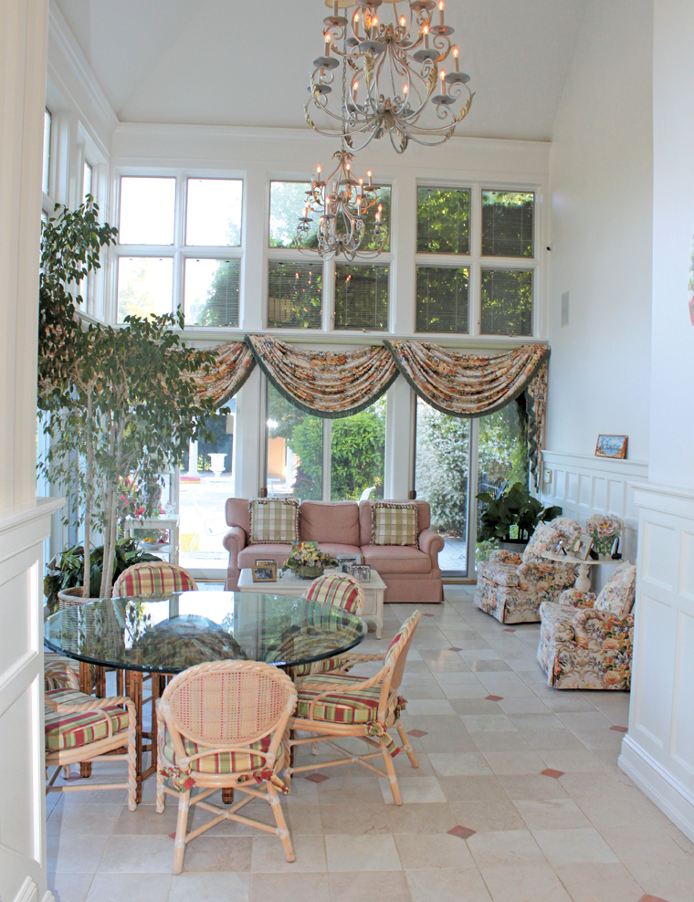 This bright sunroom is the family's go-to space for breakfast, lunch or just gathering.