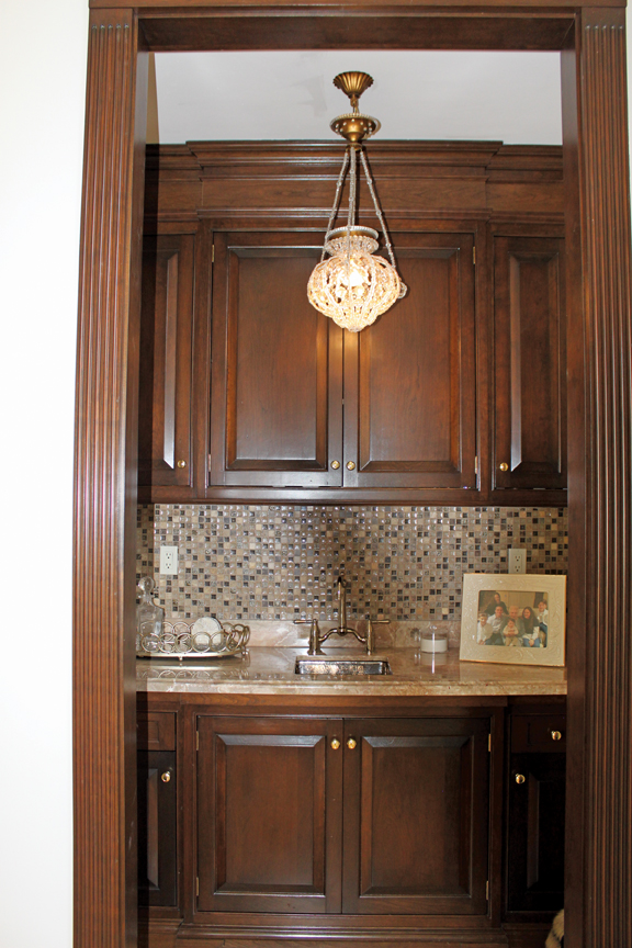 This little bar area was created from a small coat closet in the great room. Its location was convenient for entertaining guests.