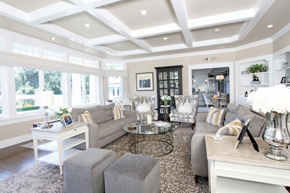 The first round of decorating began in the main home's kitchen and family room. Soft greys and beiges with crisp white moldings and bookcases enhance the ideal place for this young family to congregate.