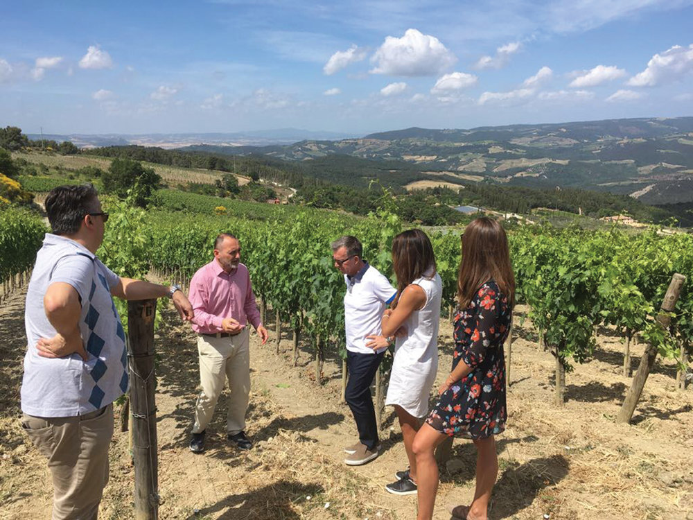 Marco Molesini takes a group of his best customers on an excursion to Podere Forte vineyard.jpg