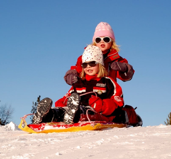 sweden-children-girls-sled-70448.jpg