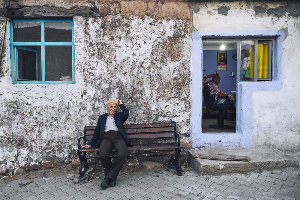 Man on a bench in a Turkish village