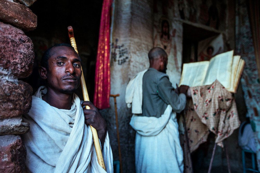 Men in a rock church, Tigray, Ethiopia