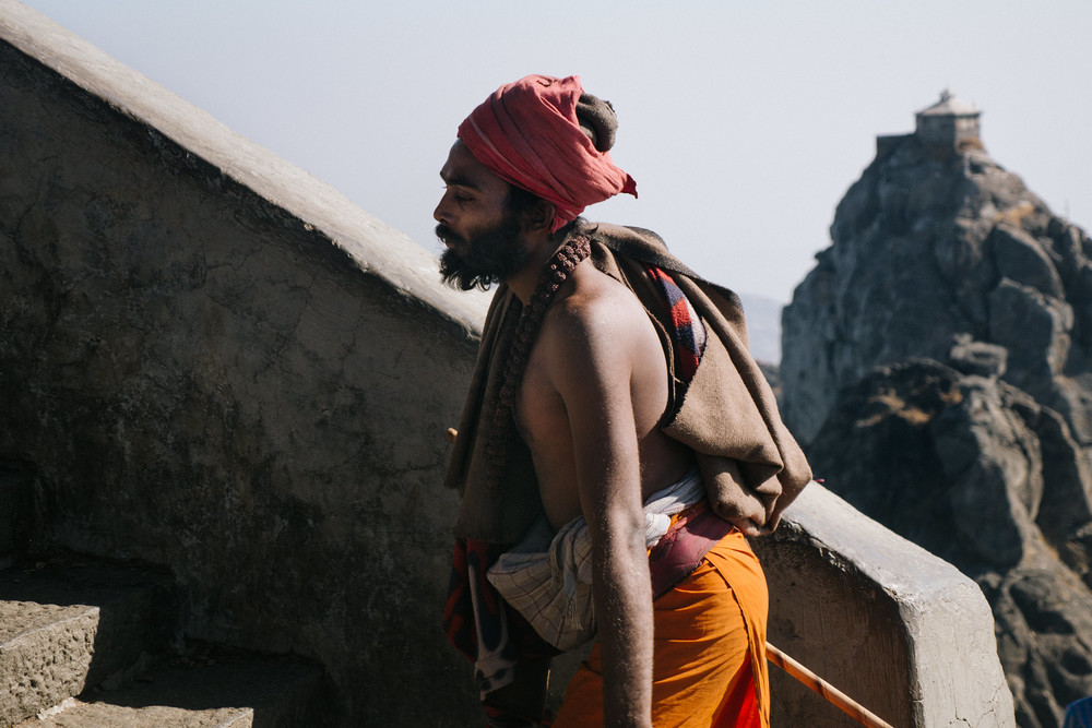 Sadhu with Girnar hill in the background
