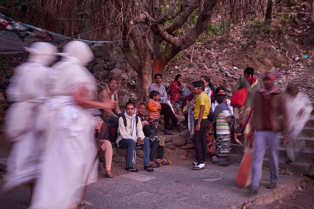 Pilgrims resting under a banyan tree
