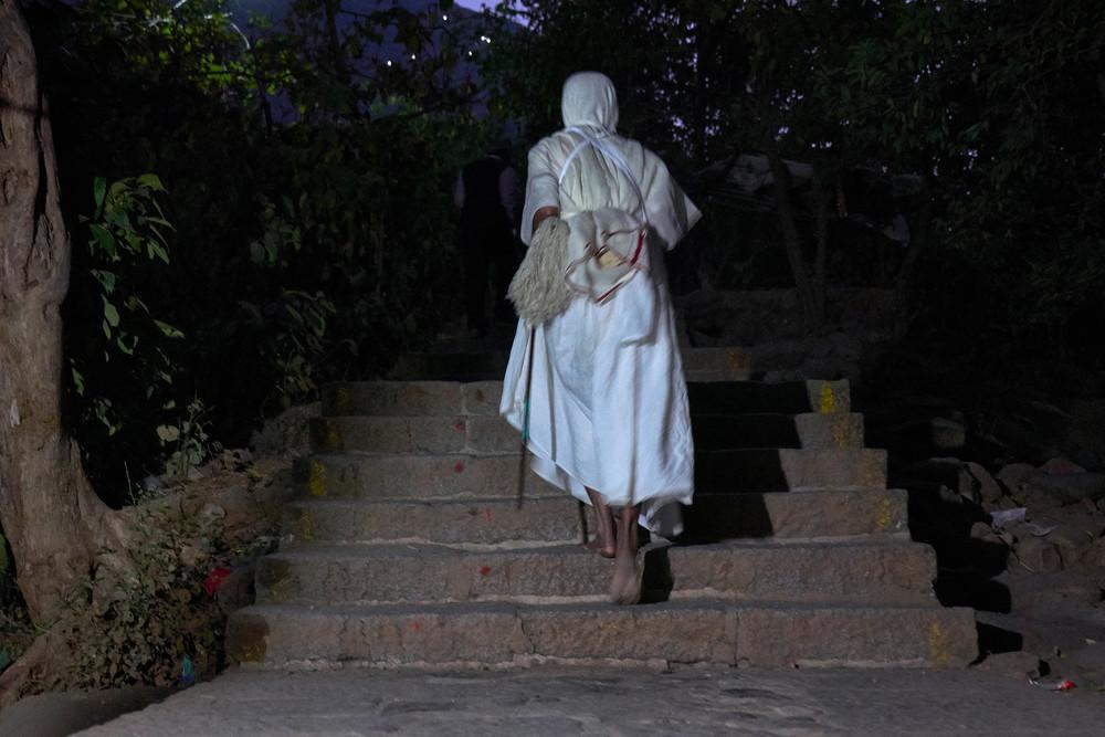 Jain nun walking up the steps of Girnar hill