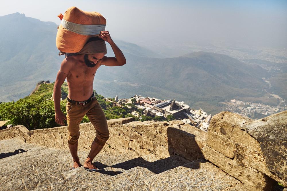Man carrying a load up Girnar hill