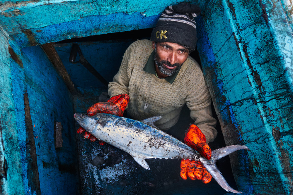 Man with a tuna in his hands