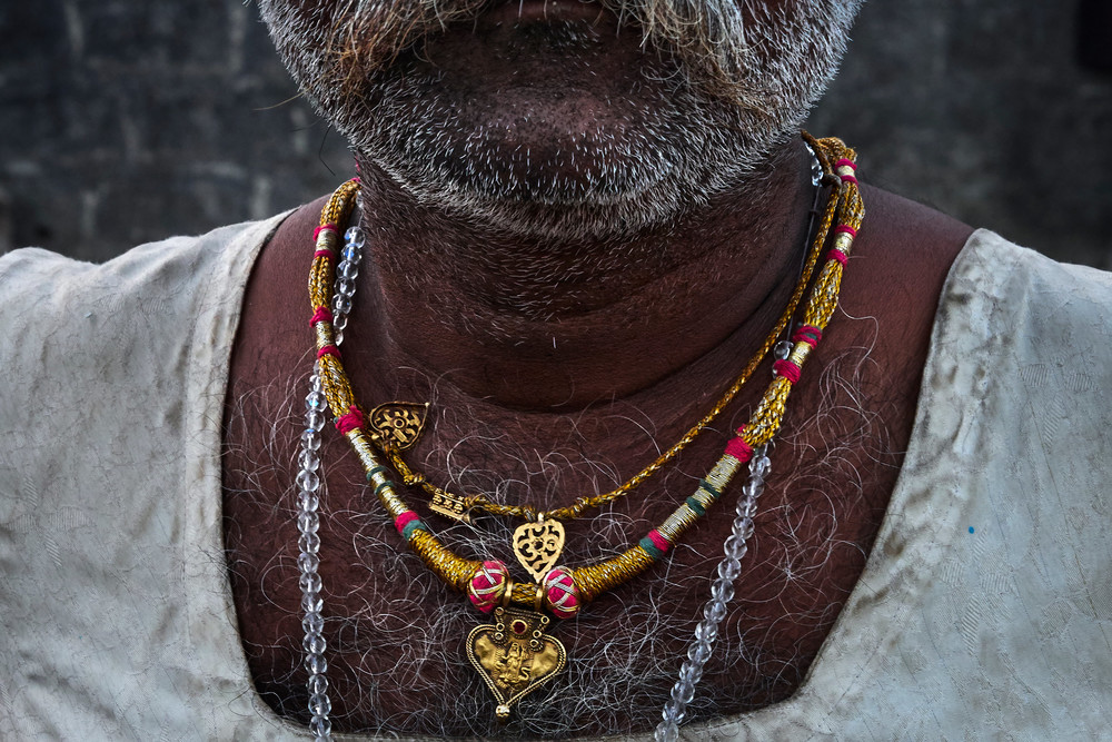Necklace on the chest of an iron-worker