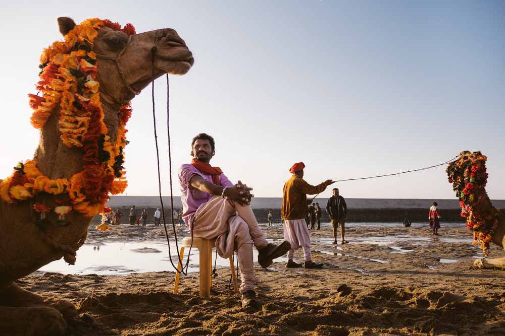 Camel man waiting for clients