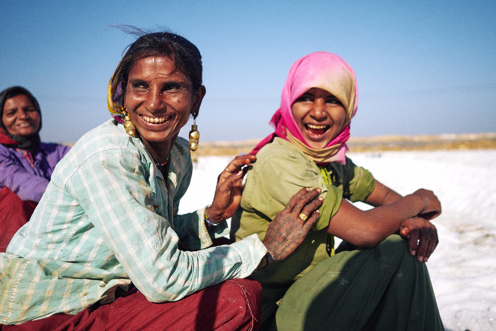 Women salt workers laughing