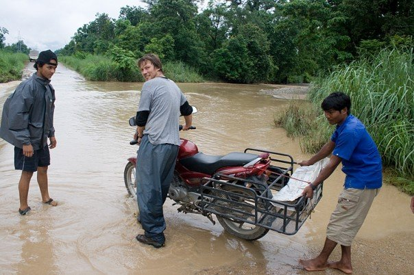 Yours truly tryuing to get the motorcycle across a monsoon flooded road