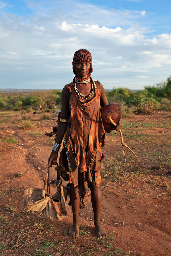 Portrait of a Hamer woman returning from the farm