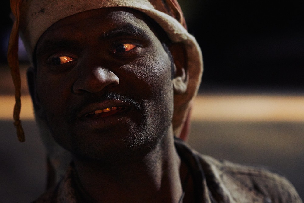 Road worker with red eyes