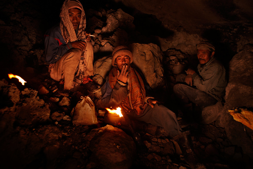 Sulfur miners taking a break before sunrise
