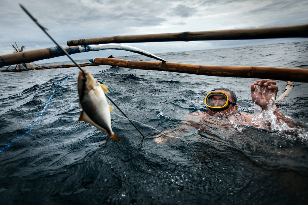 Filipino spear-fisherman with his catch