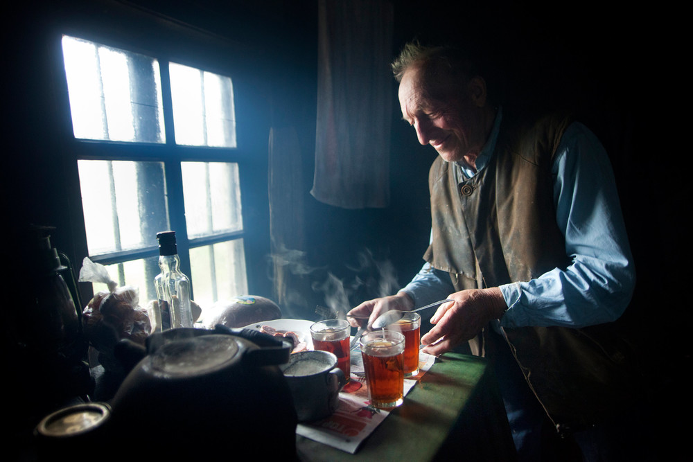 Belarusian man making tea inside his house