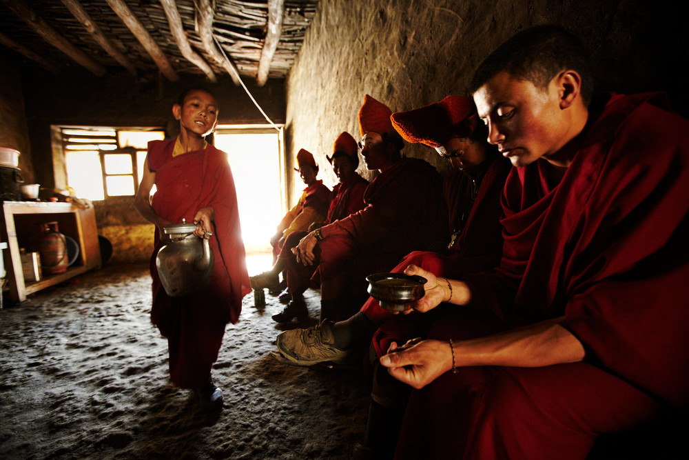 Monks having tea in a monastery kitchen