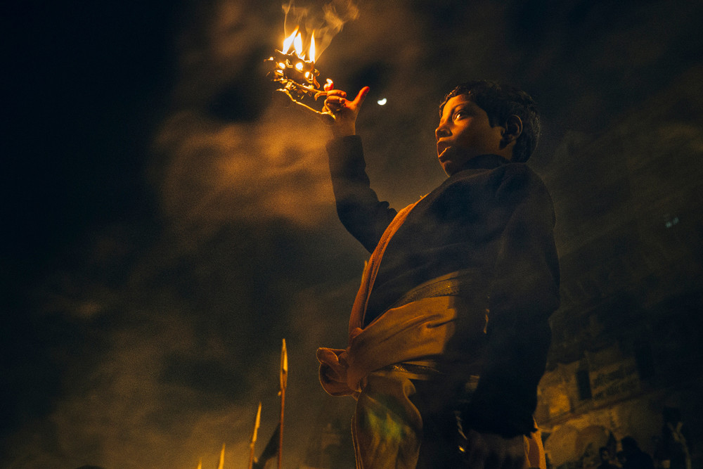 Young boy practicing Ganga Aarti