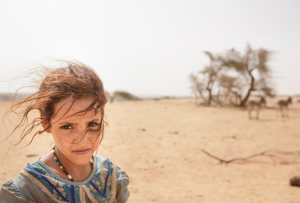 Mauritanian village girl in the desert.