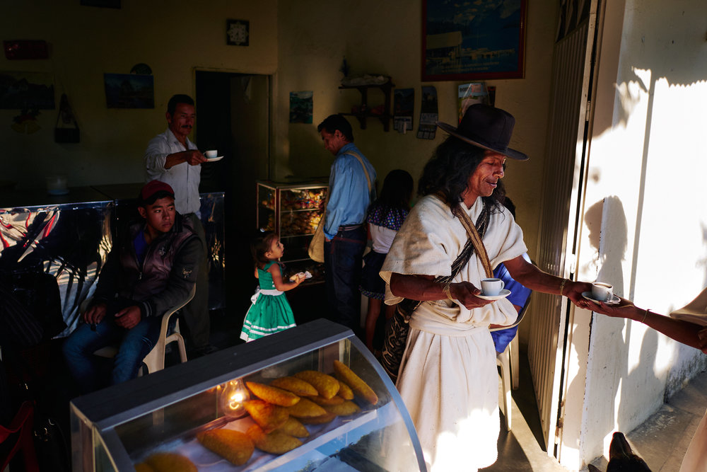 Arhuaco families come to Pueblo Bello in the morning to do business or to shop, but before that it's coffee time.