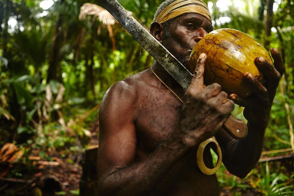 Smol Namba chief drinking coconut water