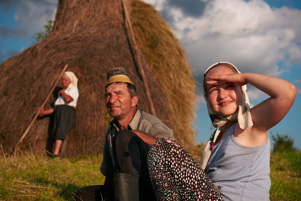 Rural-family-working-on-hay-fields-Maramures-Romania