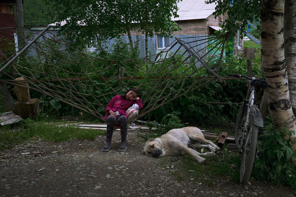 Svaneti-Ushguli-girl-with-shepherd-dog